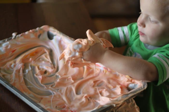 Add some food coloring to shaving cream for a fun sensory activity!