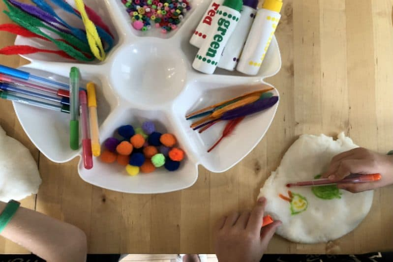 Your child will love coloring on play dough in this easy and fun sensory art activity!