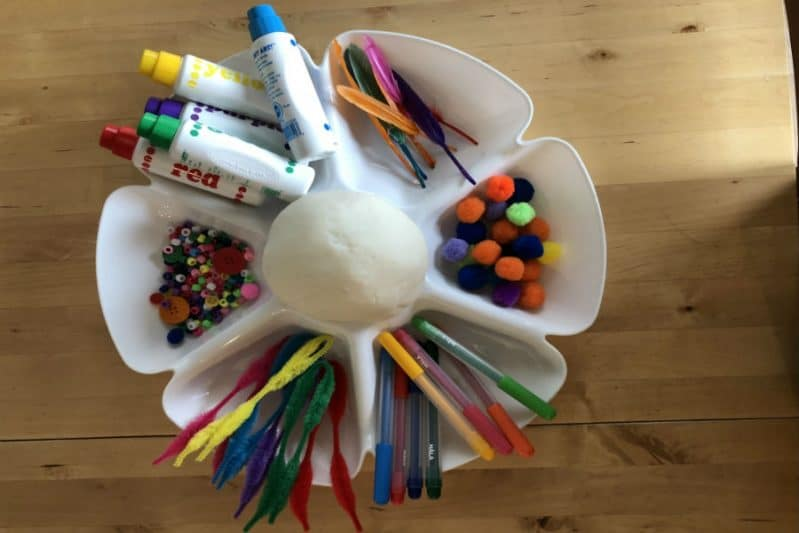 Use crafts supplies you have on hand for a simple sensory play dough art activity!