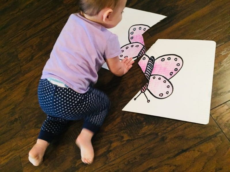 Does your child love puzzles? They'll love making their own puzzle with this DIY cardboard puzzle for toddler and babies!