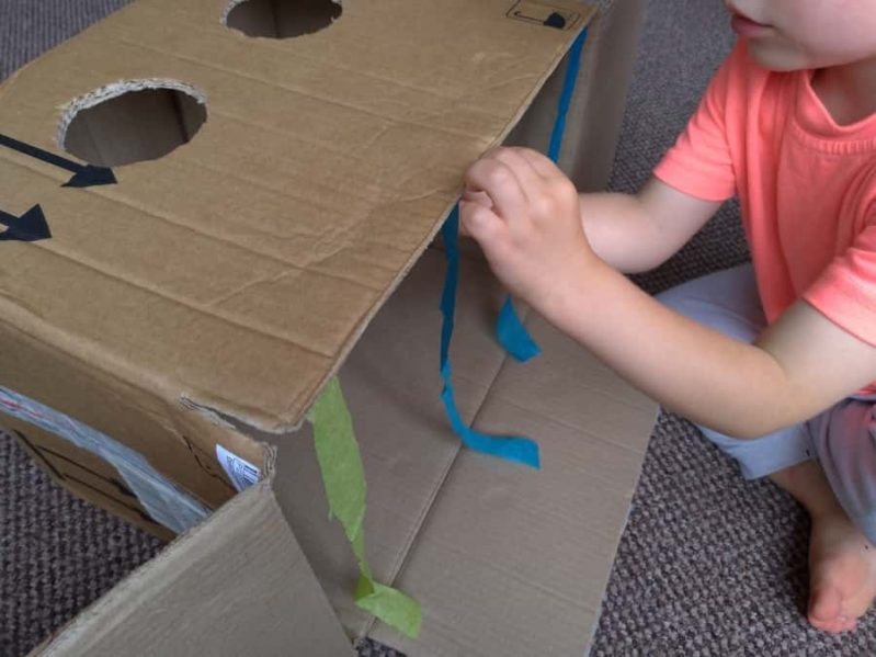Decorate your DIY sensory guess what's in the box game with the tissue paper or ribbons or party streamers.