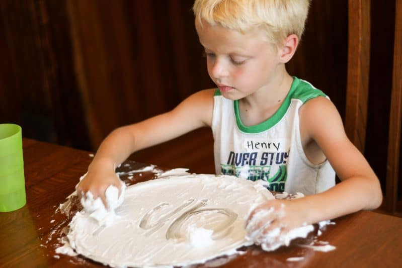 Help your child fall in love with writing when you add in fun sensory materials, like shaving cream!