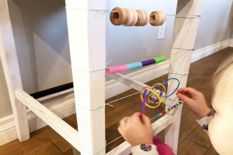 Use objects around your house to practice toddler counting skills with a DIY abacus.