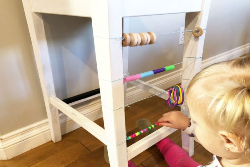 Use beads and other O-shaped objects to make a DIY abacus for your toddler!
