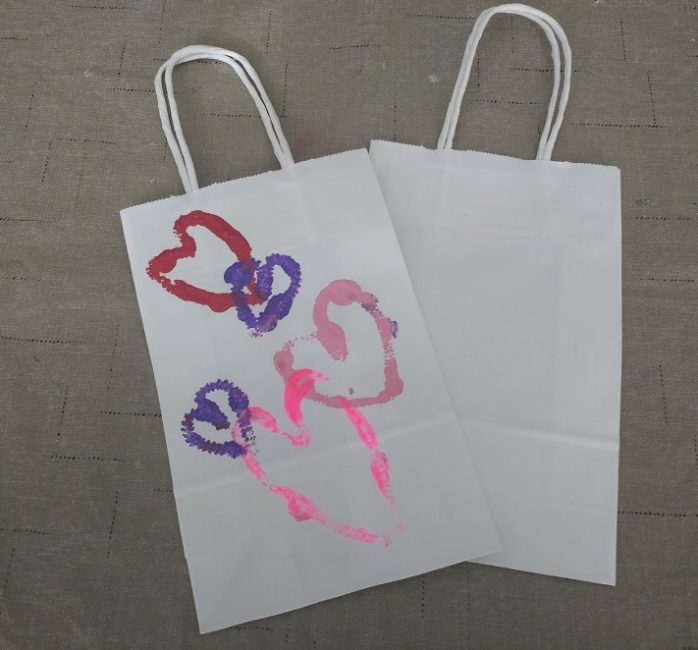 Valentine's Day goody bags with stamped heart designs