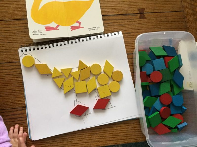 This art project for kids uses colorful tangram blocks and inspiration from Eric Carle to create fun abstract art!