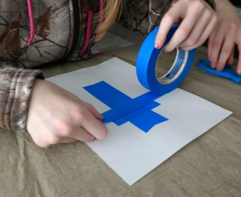 Make a tape resist cross using and Easter eggs painting technique!