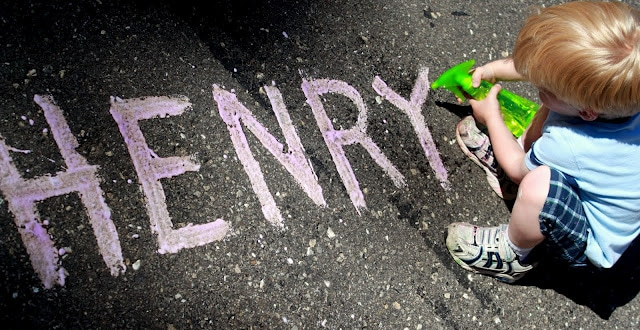 Challenge your child to spray their name - written in chalk - off the driveway or sidewalk!