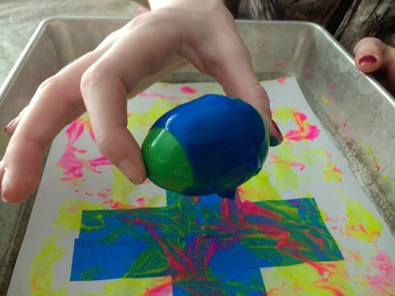 Try different painting techniques using plastic Easter eggs!