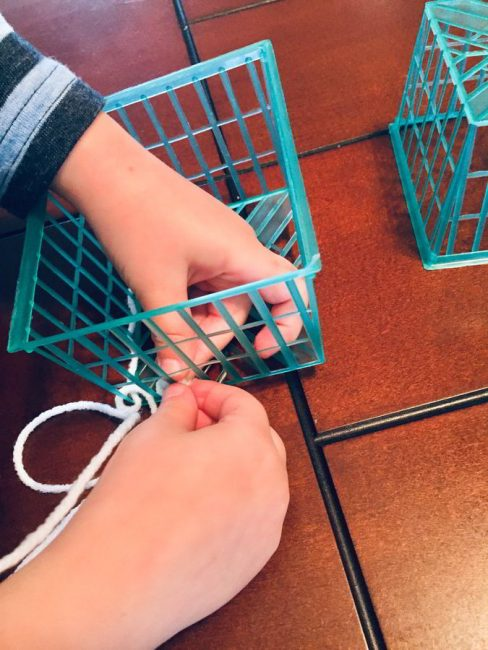 This simple woven strawberry basket craft is perfect to hold your child's favorite toys or collections! Make this hands-on woven craft with just a few simple materials.