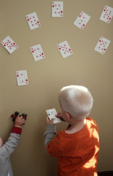 Playing cards set up for a number match game