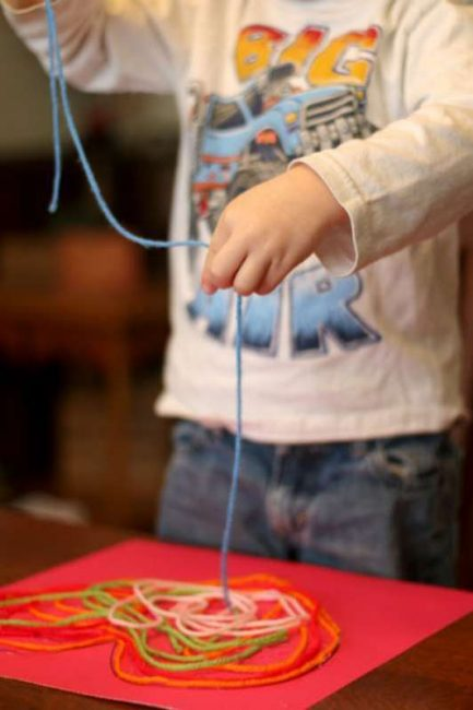 Your toddler will love making loopy piles of yarn for a Valentine's Day heart craft!