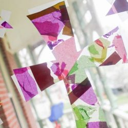 A beautiful and simple cross Easter craft for kids (especially toddlers) to make for a Christian art project with contact paper that has a stained glass cross effect! So pretty!