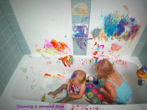 Moving messy activities into the bathtub makes cleaning up super simple.