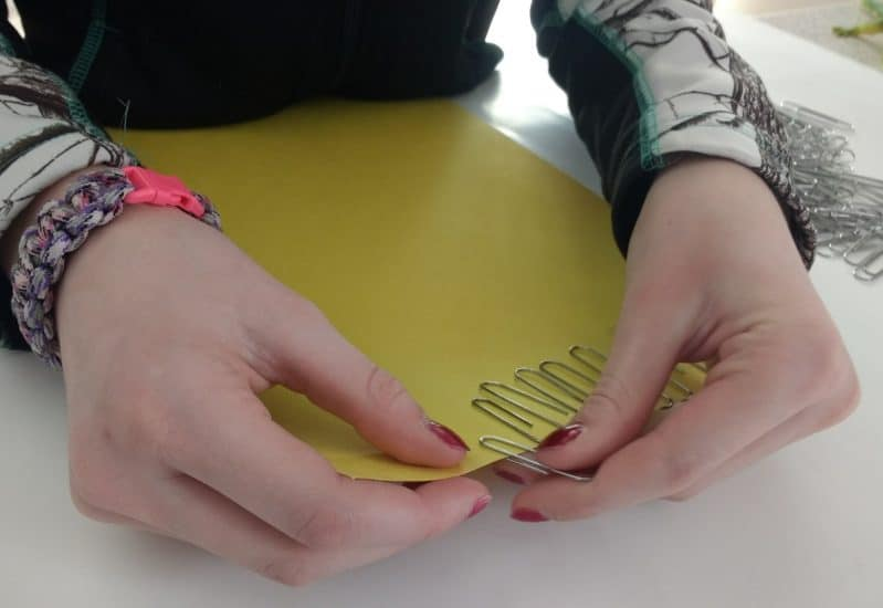 Put paper clips onto construction paper for a simple fine motor activity!