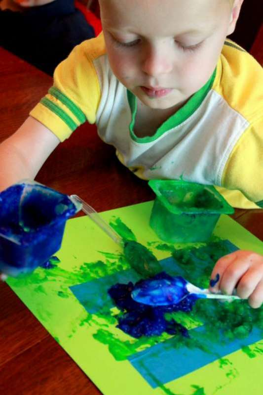 Create your own tape resist letters or designs using homemade edible finger paint