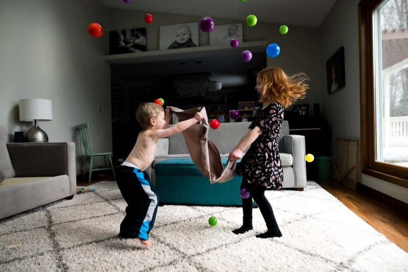 Jump around and bounce small toys off a pillowcase!