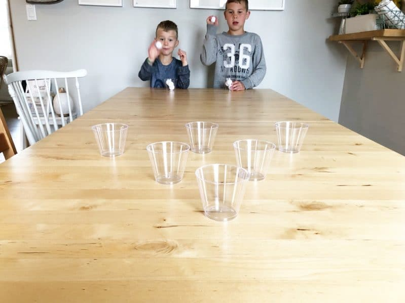 Toss, bounce, and catch the ping pong ball in a cup!
