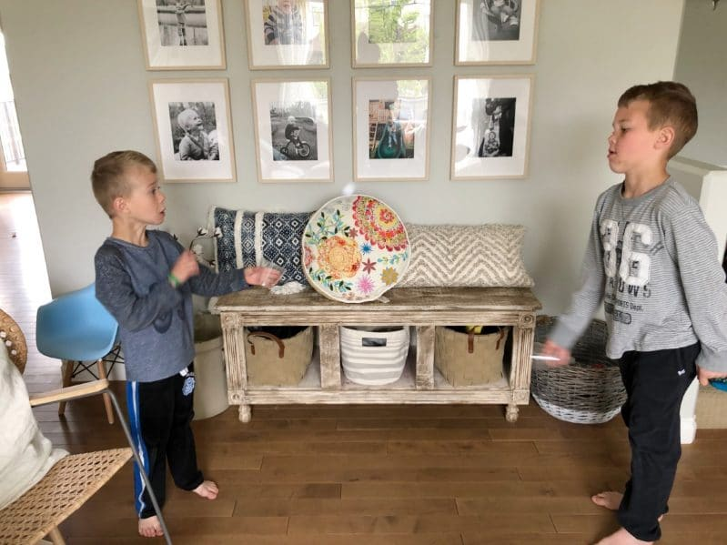 Challenge your kids to throw and catch the ping pong ball between two cups! How many rounds can they go without dropping?