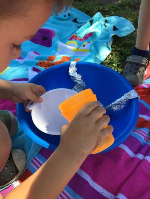 This tin foil water play activity is so fun! Your kids will love this easy idea for summer water play.