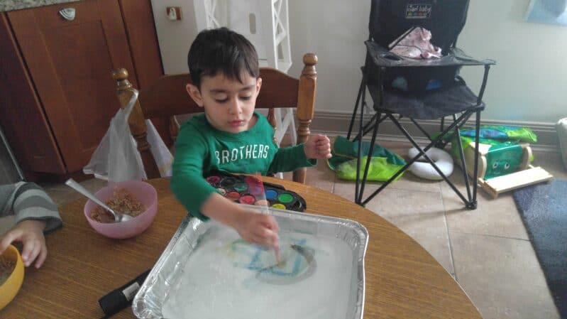 Do a little ice painting with your child! It's a simple, easy to clean up art + science experiment!