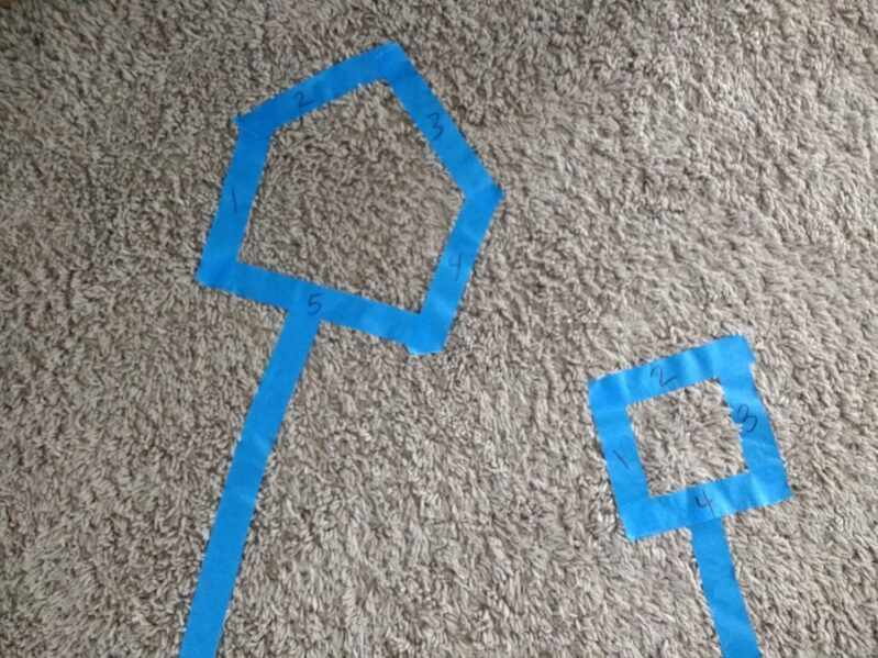 Fun activity for kids using painter's tape, cotton balls, and clothespins to practice counting, fine motor skills, gross motor skills, and colors.