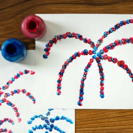 Finger paint a pretty fireworks show with your kids for the 4th of July!