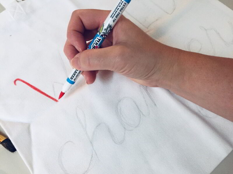 Older kids can trace over the penciled in guide letters on the canvas bag.