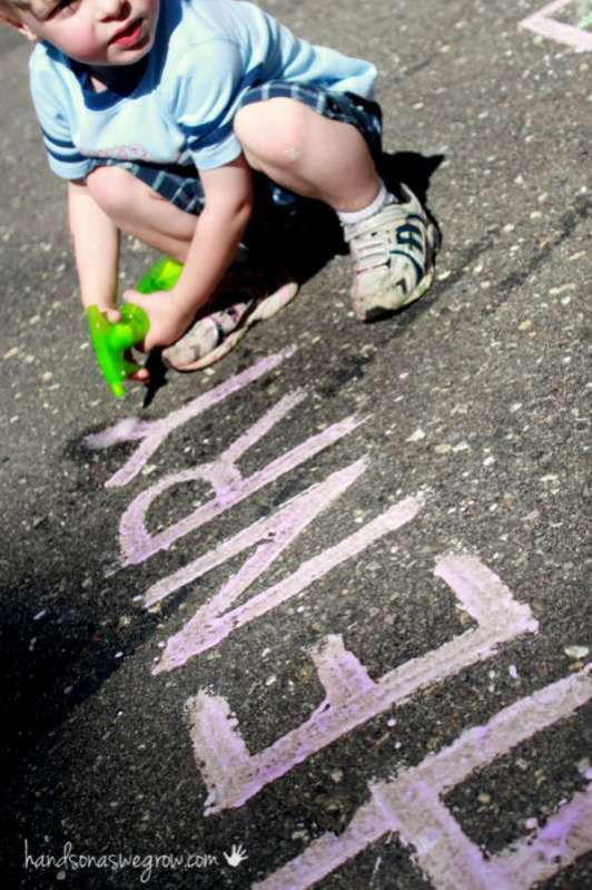 Spray your fizzy sidewalk chalk paint with vinegar to watch it foam up!