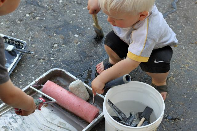 Try painting the driveway for a quick and easy summer activity!