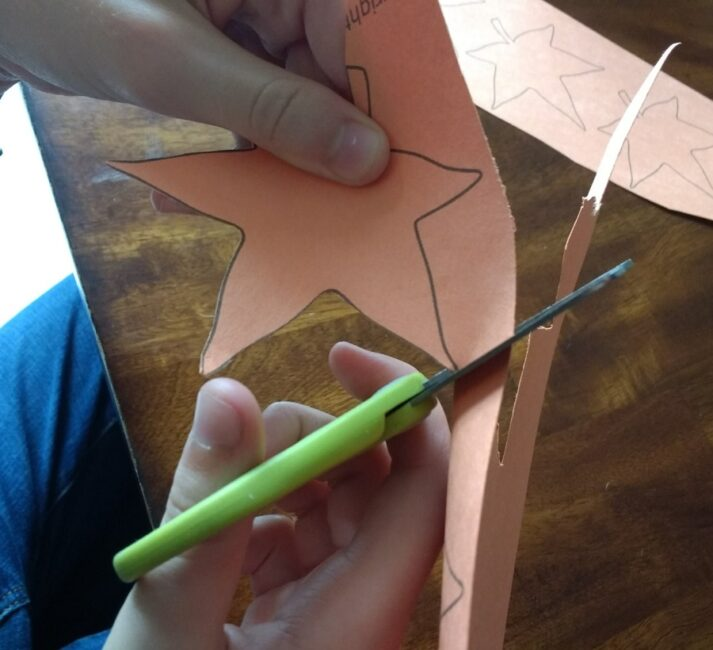 Cutting out fall leaves is perfect for fine motor skills practice!
