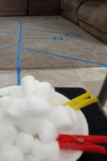 Clothespins, cotton balls, and painter's tape make a fun low-prep hands-on activity challenge that kids love!