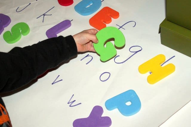 A letter hunt is one of the alphabet activities that help preschoolers learn the uppercase and lowercase letters.