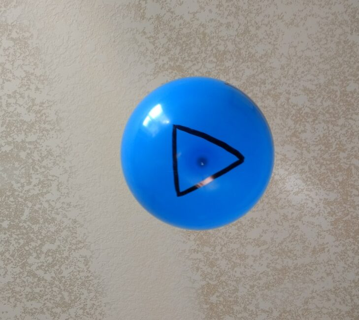 Work on matching shapes with a fun balloon game challenge!