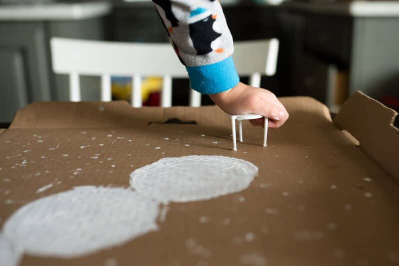 A recycled snowman painting project for kids is a perfect winter craft!
