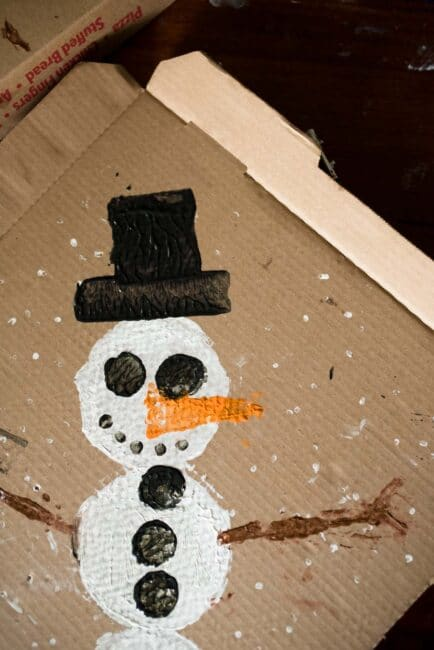 Try a fun recycled snowman painting project for kids this winter!