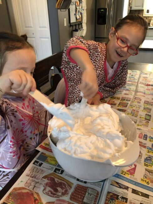 Mixing up a shaving cream sensory experience together for inside winter fun