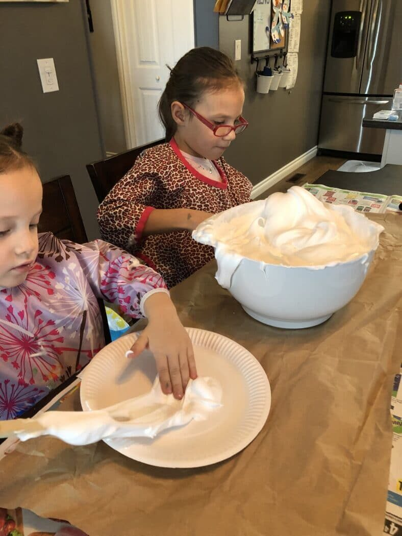 Spread the shaving cream sensory foam to make your snowman's face