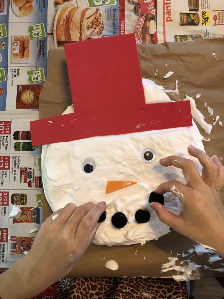DIY a snowman inside with shaving cream sensory foam!