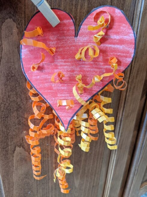Hang your ribbon heart fine motor craft for kids to make in your house for Valentine's Day!