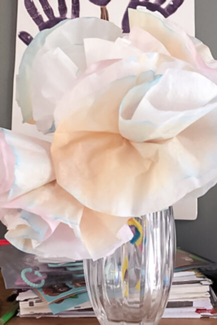 Add a splash of spring color to your house, even before the flowers bloom! This simple DIY coffee filter flowers craft is so easy and fun!