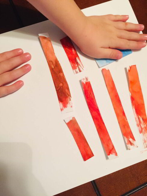 Turn your red and blue squares into a US flag collage for a President's Day preschool art activity