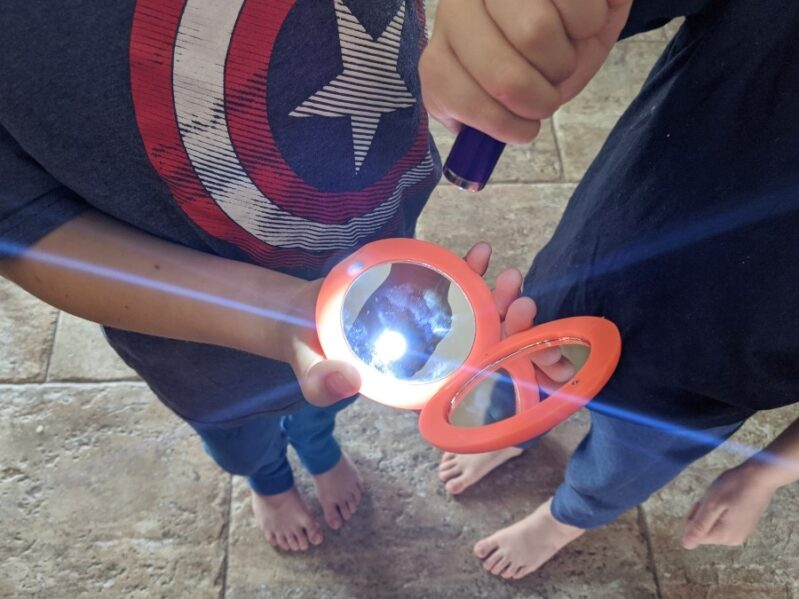 Check to see what objects reflect with easy light experiments for kids