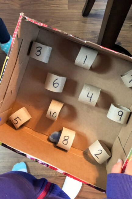 Build a creative number maze with pom poms and toilet paper tubes, just like our MOTM Shawna.