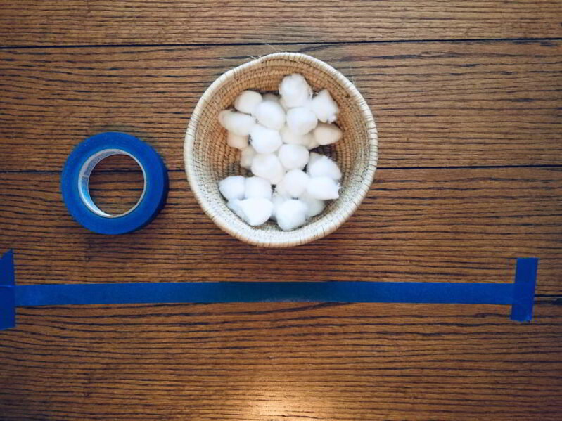Try this cotton ball lineup for a simple, fun toddler fine motor activity!