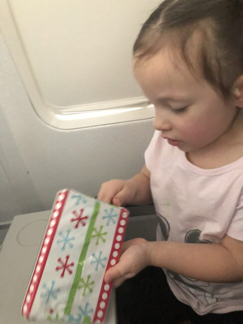 Wrap small presents for your child to unwrap on the plane. A sneaky way to work on fine motor skills while entertaining kids on a plan.