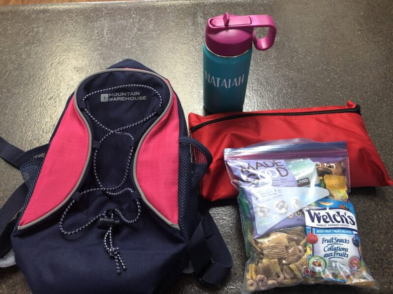 Peek inside our backpacks for easy no-screen ways to entertain kids on a plane