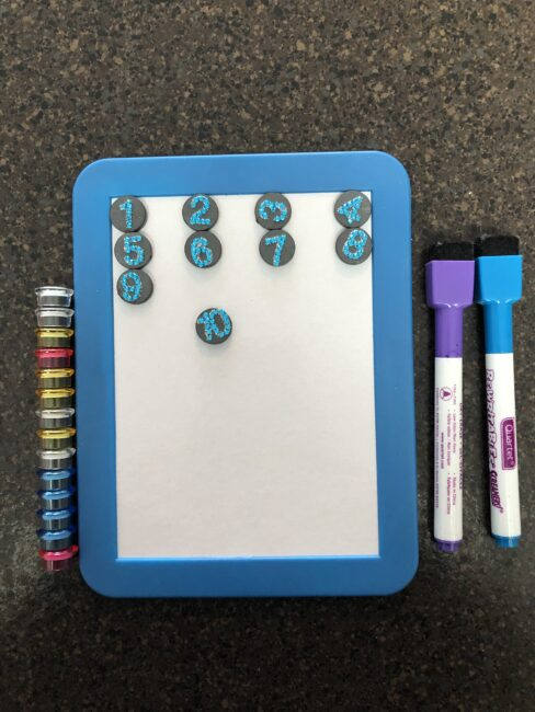 Use a magnet white board for fun no-screen ways entertain kids on a plane!