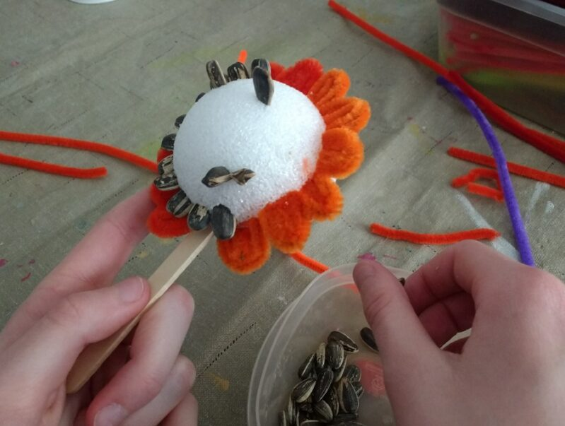 spring flower craft with sunflower seed centers