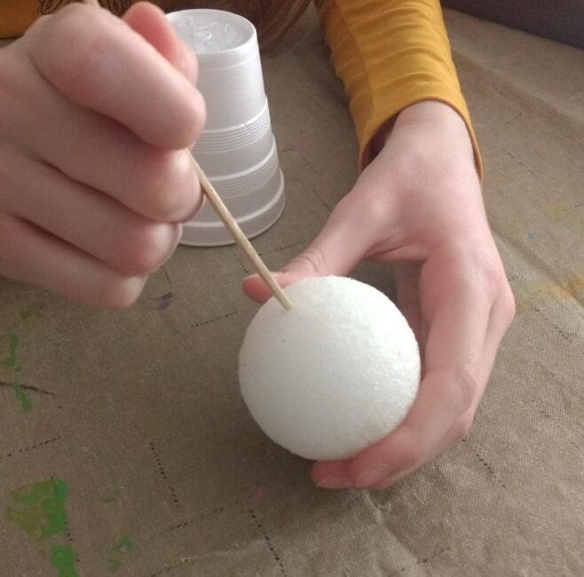 start making a pipe cleaner flower with a craft stick and styrofoam ball